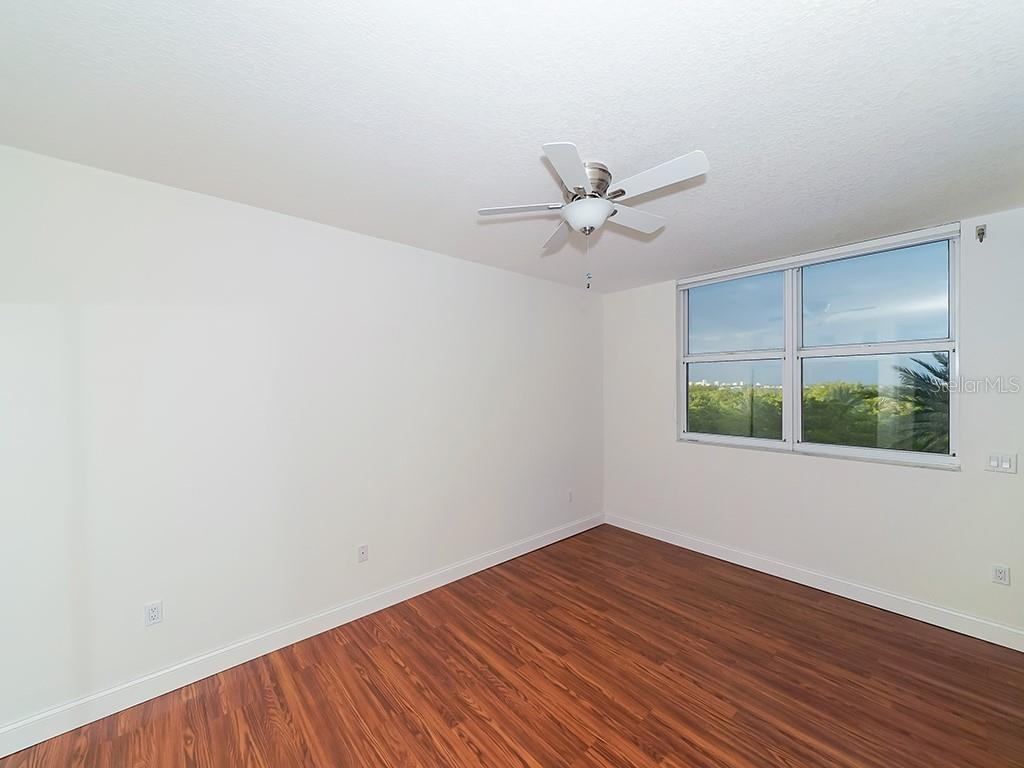 Guest Bedroom #1 - Access to Bay Terrace - Condo for sale at 1800 Benjamin Franklin Dr #b409, Sarasota, FL 34236 - MLS Number is A4408201