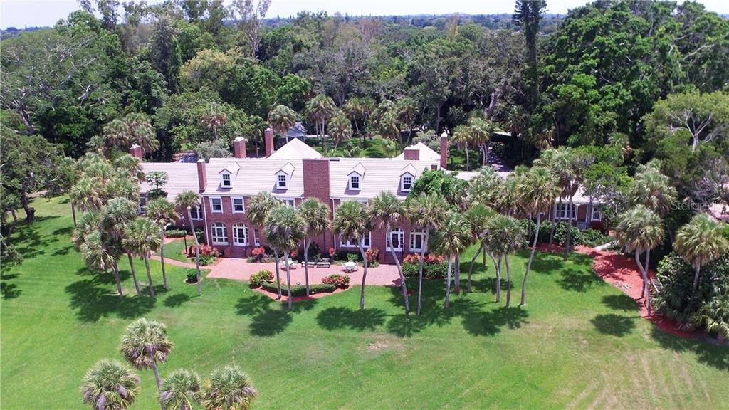 Magnificent aerial view of home, expansive brick terrace, dormers and fireplace chimneys - Single Family Home for sale at 4820 Riverview Blvd, Bradenton, FL 34209 - MLS Number is A4408263