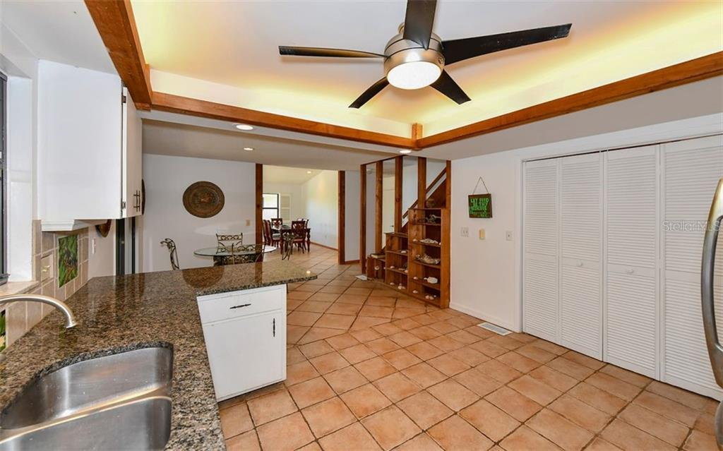 Lighted Tray Ceiling in Kitchen - Single Family Home for sale at 1238 Sea Plume Way, Sarasota, FL 34242 - MLS Number is A4408272
