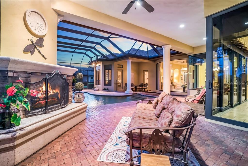 Outdoor living with Fireplace - Single Family Home for sale at 7570 Preservation Dr, Sarasota, FL 34241 - MLS Number is A4409986