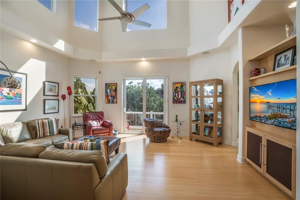 Living Room 21ft soaring ceiling, opens to deck. - Single Family Home for sale at 4929 Oxford Dr, Sarasota, FL 34242 - MLS Number is A4410964