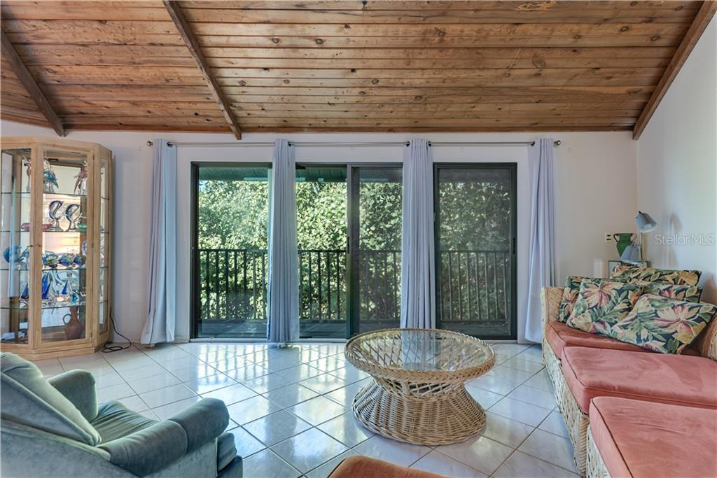 Family room, open concept - Single Family Home for sale at 6661 Gulf Of Mexico Dr, Longboat Key, FL 34228 - MLS Number is A4410988