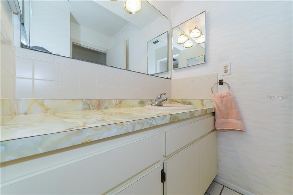 Guest bathroom - Single Family Home for sale at 5591 Cape Aqua Dr, Sarasota, FL 34242 - MLS Number is A4411099