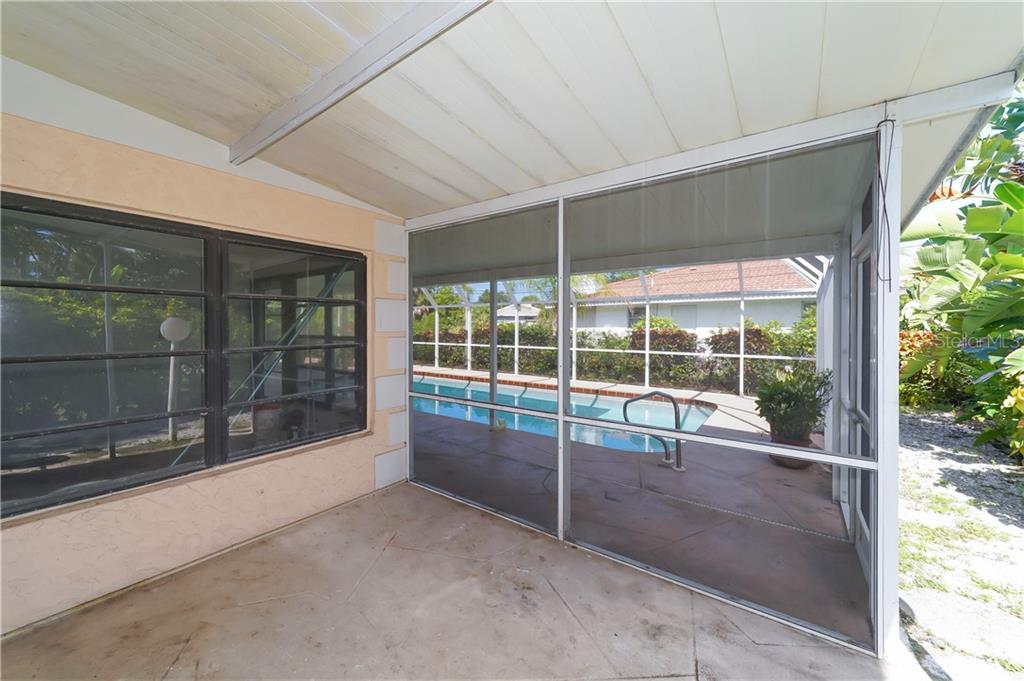Storage area for bikes, beach chairs, pool equipment. - Single Family Home for sale at 5591 Cape Aqua Dr, Sarasota, FL 34242 - MLS Number is A4411099