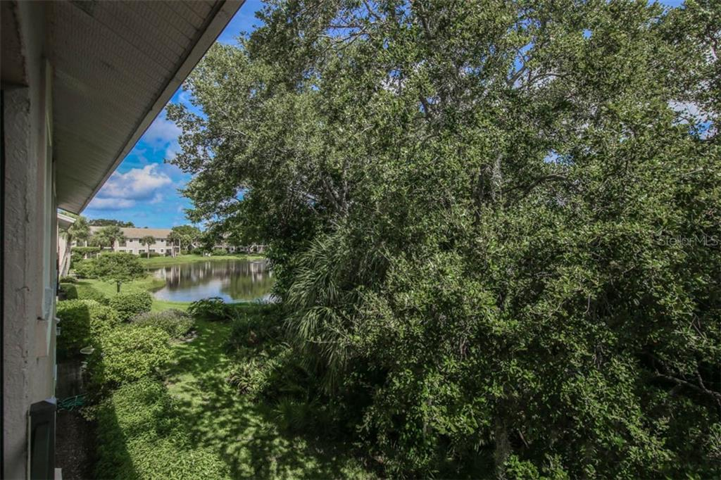 Step around the rear of the unit and take a stroll around Lake Starling. - Condo for sale at 1716 Starling Dr #204, Sarasota, FL 34231 - MLS Number is A4412237