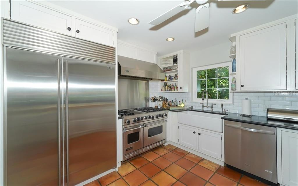 No expense was spare for the professionally equipped kitchen - note the Subzero refrigerator/freezer, the Viking gas range with double oven and cook top and hood. - Single Family Home for sale at 138 Island Cir, Sarasota, FL 34242 - MLS Number is A4412265