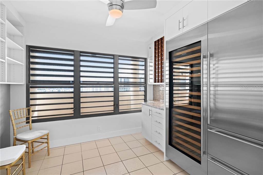 Chef's pantry off of kitchen with wine refrigerator. - Condo for sale at 1255 N Gulfstream Ave #1502, Sarasota, FL 34236 - MLS Number is A4413205