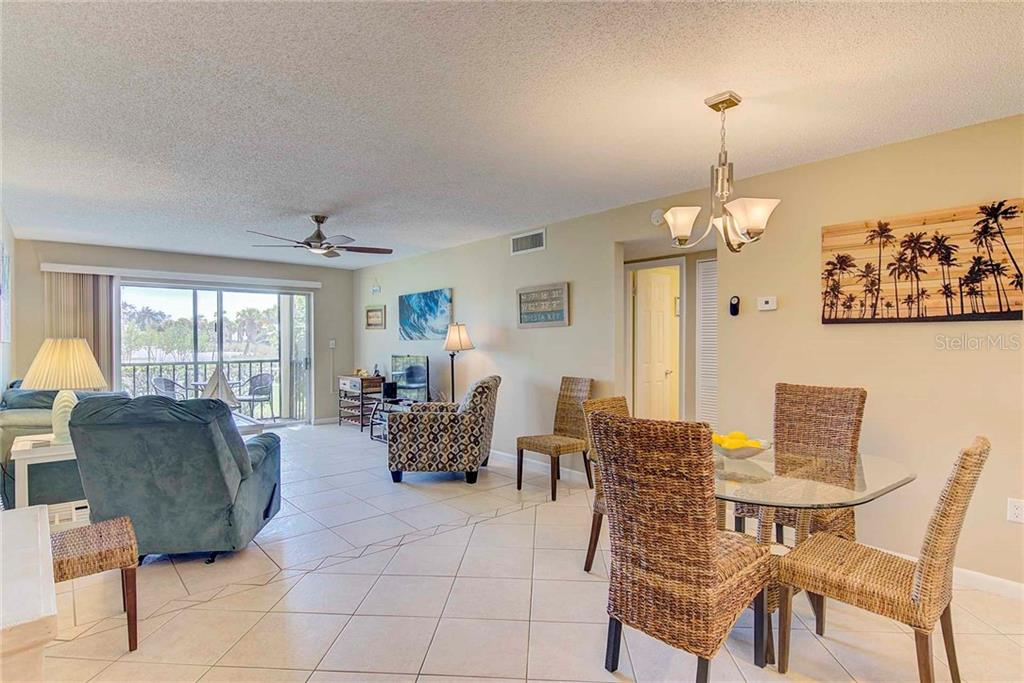 Dining Room and Living Room - Condo for sale at 925 Beach Rd #107b, Sarasota, FL 34242 - MLS Number is A4413716