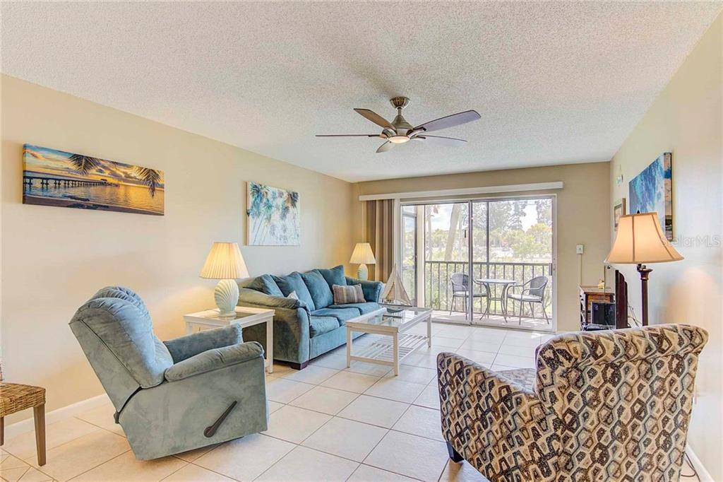 Living Room Looking out to Patio and Siesta Key Beach - Condo for sale at 925 Beach Rd #107b, Sarasota, FL 34242 - MLS Number is A4413716