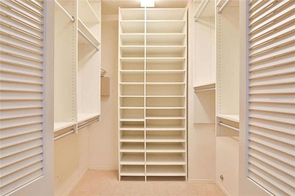 Master walk-in closet. - Villa for sale at 7686 Calle Facil, Sarasota, FL 34238 - MLS Number is A4413755