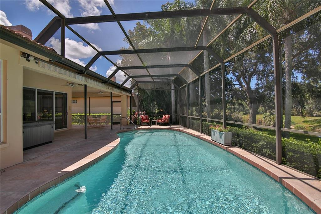 Plenty of covered and open sitting areas on the lanai. - Villa for sale at 7686 Calle Facil, Sarasota, FL 34238 - MLS Number is A4413755