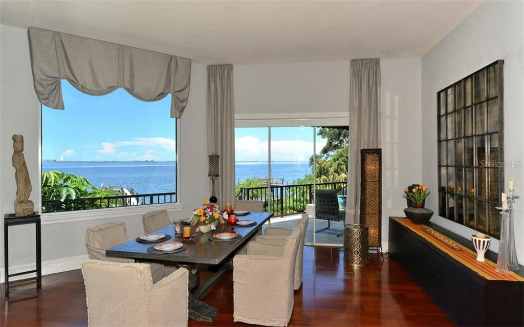 Formal Dining room w/Bay views & balcony. - Single Family Home for sale at 2145 Alameda Ave, Sarasota, FL 34234 - MLS Number is A4414337