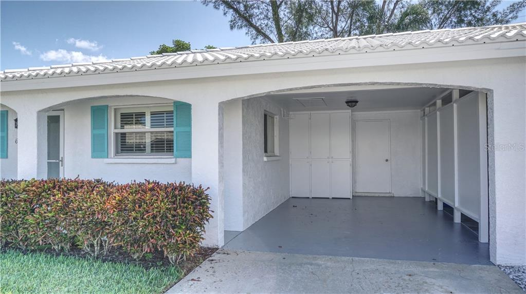 Carport with cabinets and walk-in storage room. - Villa for sale at 682 Spanish Dr S, Longboat Key, FL 34228 - MLS Number is A4414905