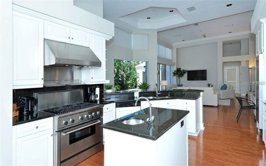 A Thermador 6-burner gas range and an island with a prep sink will make cooking truly enjoyable. - Single Family Home for sale at 3529 Fair Oaks Ln, Longboat Key, FL 34228 - MLS Number is A4414992