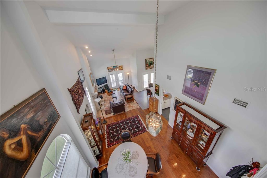 Looking from the 3rd floor walkway out over the beautiful great room with it's soaring ceilings and amazing light - Single Family Home for sale at 660 Marbury Ln, Longboat Key, FL 34228 - MLS Number is A4415911