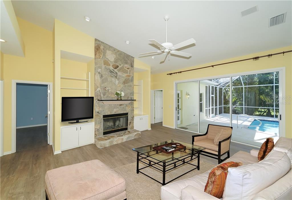 Family room virtually staged - Single Family Home for sale at 1714 79th Ct W, Bradenton, FL 34209 - MLS Number is A4416601