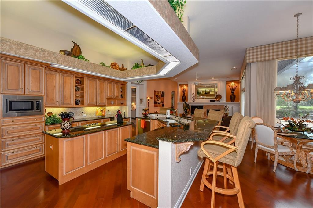 Kitchen - Single Family Home for sale at 7659 Alister Mackenzie Dr, Sarasota, FL 34240 - MLS Number is A4416607