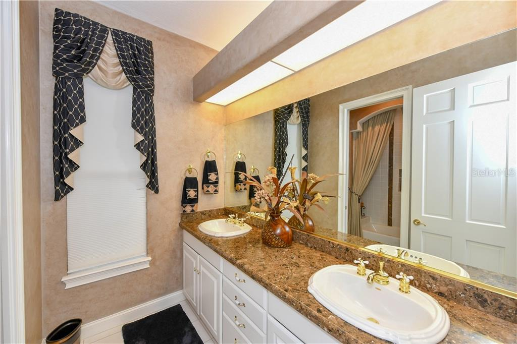 Guest Bathroom (Bath Two) - Single Family Home for sale at 7659 Alister Mackenzie Dr, Sarasota, FL 34240 - MLS Number is A4416607