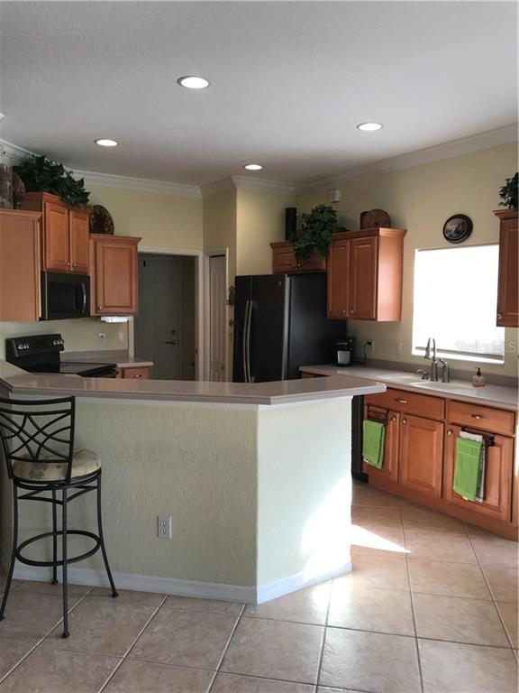 Another view of the kitchen. - Villa for sale at 252 Fairway Isles Ln, Bradenton, FL 34212 - MLS Number is A4417217