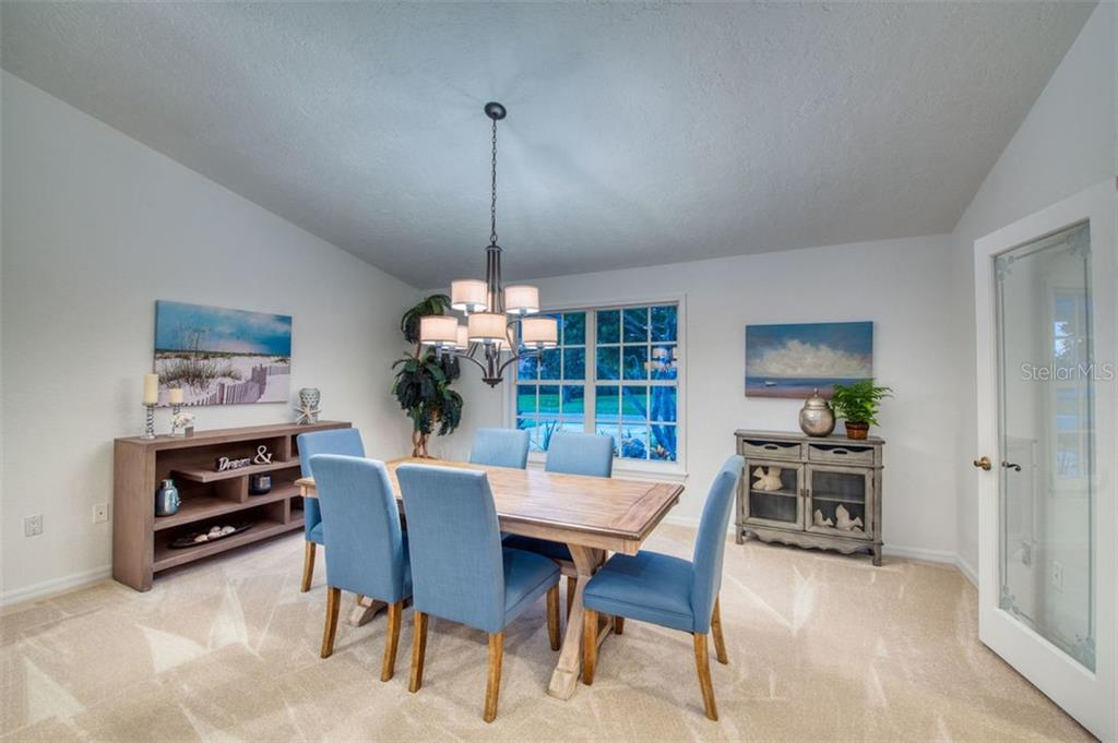 Formal dining, or use for additional living areas - Single Family Home for sale at 7689 Cove Ter, Sarasota, FL 34231 - MLS Number is A4417242
