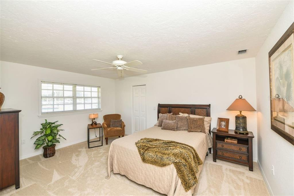 2nd lower level guest suite. Walk-in closet, some water view from this room. - Single Family Home for sale at 7689 Cove Ter, Sarasota, FL 34231 - MLS Number is A4417242