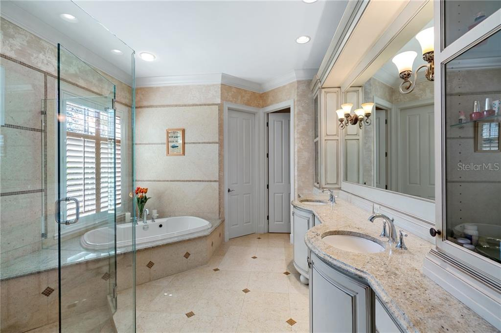 MASTER BATHROOM - Single Family Home for sale at 4121 Founders Club Dr, Sarasota, FL 34240 - MLS Number is A4417319