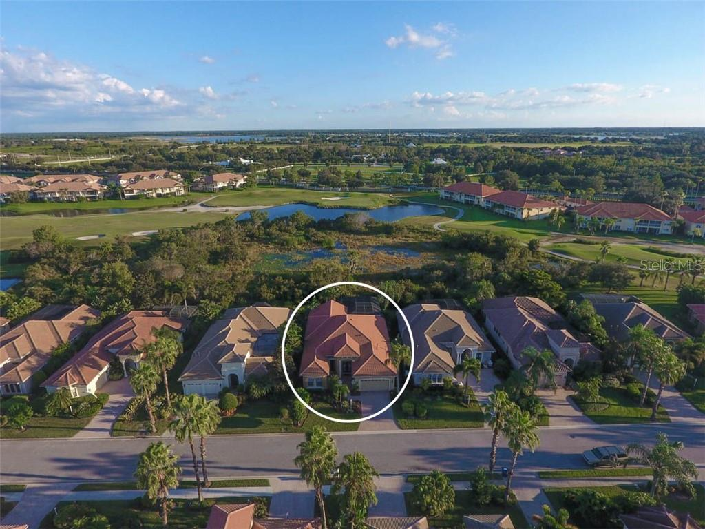 Situated on Estuary & Golf Course - Single Family Home for sale at 7060 Whitemarsh Cir, Lakewood Ranch, FL 34202 - MLS Number is A4417363