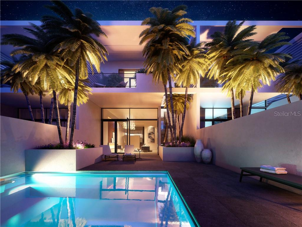 Dramatic night shot of view of private rerrace and pool through to residence's living room beyond. - Condo for sale at 1528 4th St #-, Sarasota, FL 34236 - MLS Number is A4417475