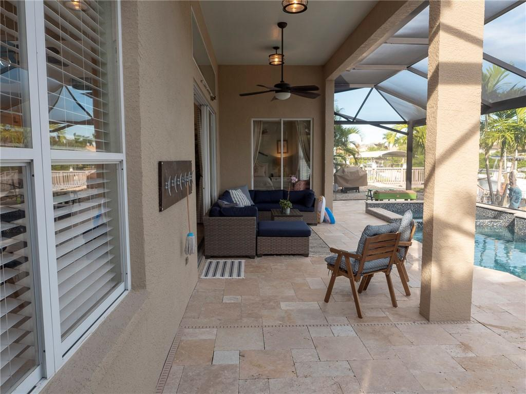 This spacious patio almost doubles the first floor living space of this home! So much room to relax and enjoy the outdoors. - Single Family Home for sale at 3803 5th Ave Ne, Bradenton, FL 34208 - MLS Number is A4417524