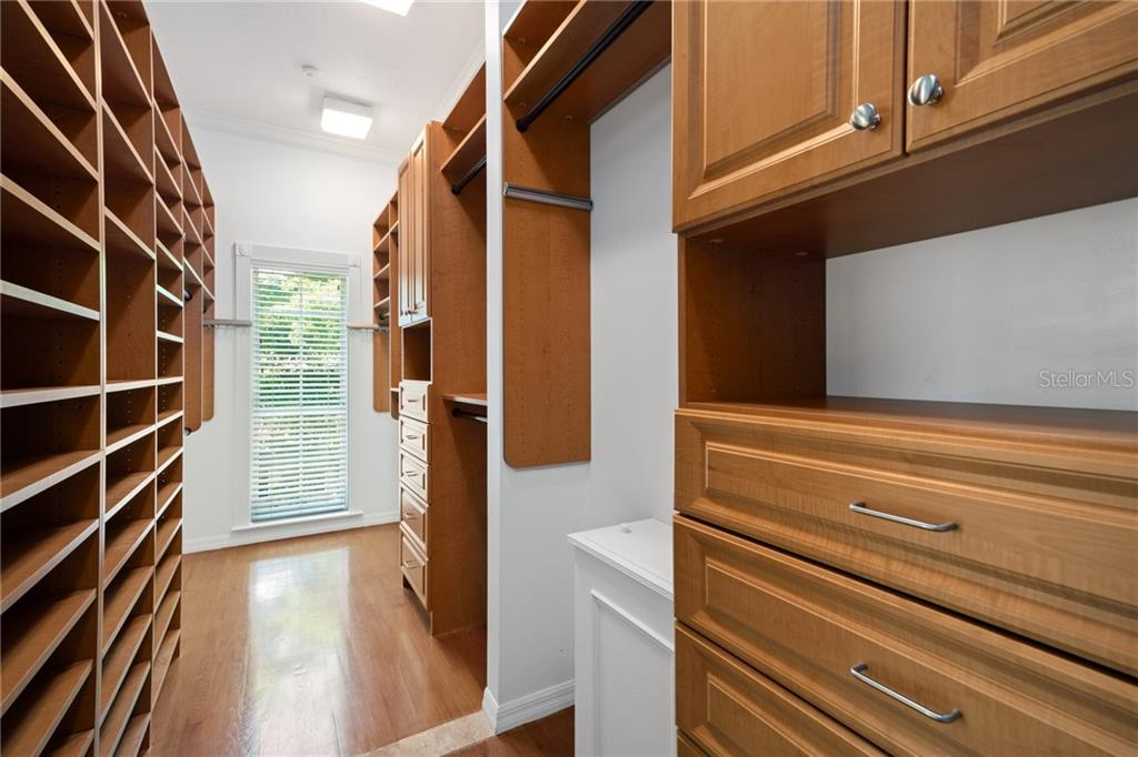 Massive luxury master suite closest with ample shelving and drawers, a large window for natural light plus a laundry shoot! - Single Family Home for sale at 1654 Landings Blvd, Sarasota, FL 34231 - MLS Number is A4417765