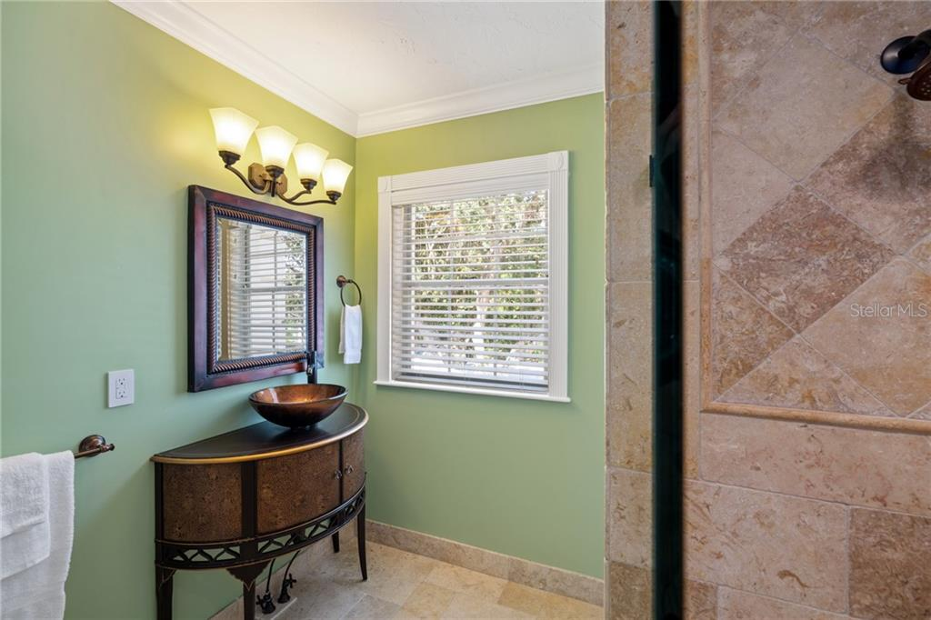 Ensuite to Guest Bedroom #4. - Single Family Home for sale at 1654 Landings Blvd, Sarasota, FL 34231 - MLS Number is A4417765
