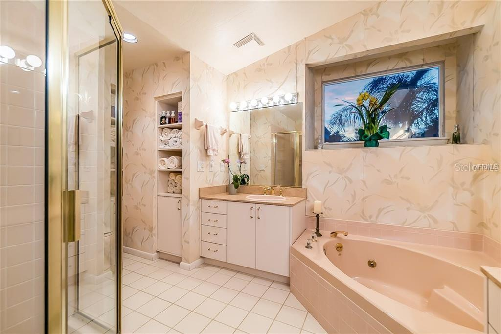 Master bath with walk-in shower and 2 vanities - Single Family Home for sale at 4963 Oxford Dr, Sarasota, FL 34242 - MLS Number is A4417783