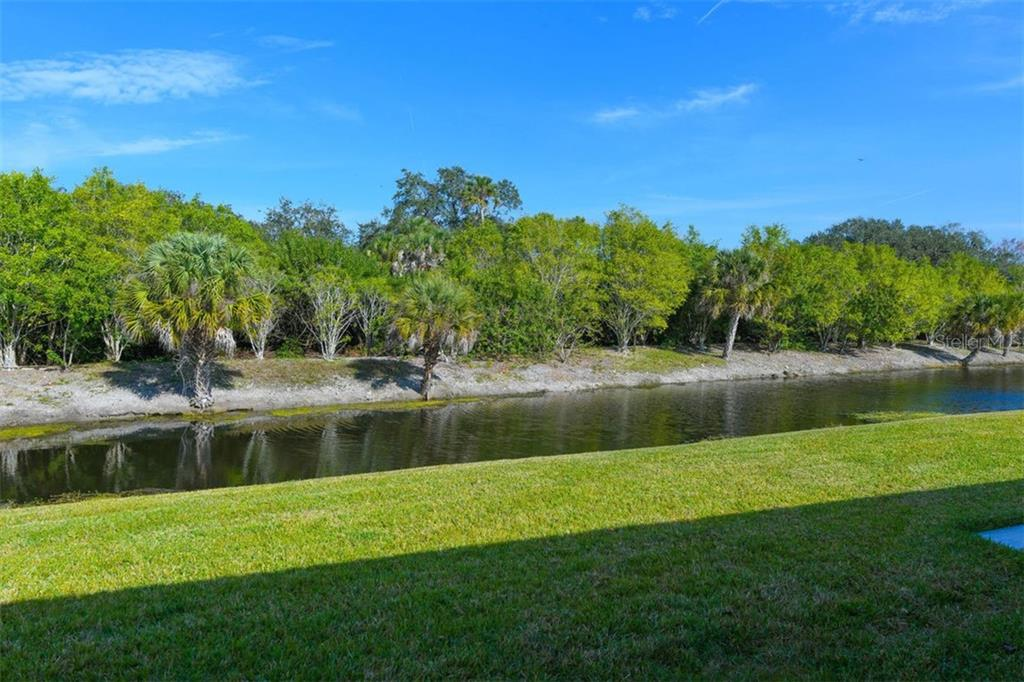 View of the waterway from the back of the villa. - Villa for sale at 3617 Gleneagle Dr, Sarasota, FL 34238 - MLS Number is A4417832