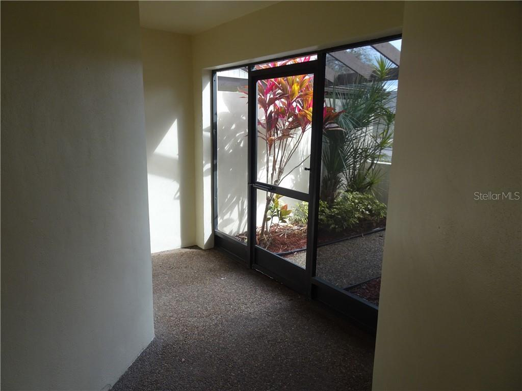 Screened front lanai. - Villa for sale at 3617 Gleneagle Dr, Sarasota, FL 34238 - MLS Number is A4417832