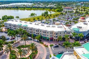 ANOTHER LOVELY VIEW OF THE COMMON AREAS OUTSIDE YOUR LIVING ROOM. - Condo for sale at 8111 Lakewood Main St #209, Lakewood Ranch, FL 34202 - MLS Number is A4418078