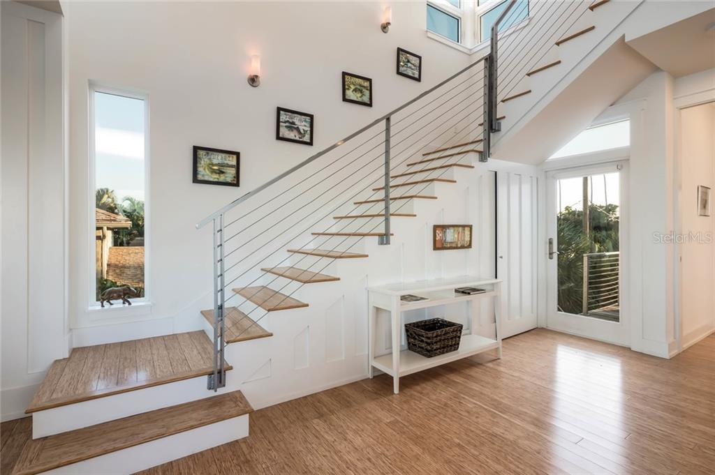 Stairs leading to the second level - Single Family Home for sale at 7130 Longboat Dr E, Longboat Key, FL 34228 - MLS Number is A4418105