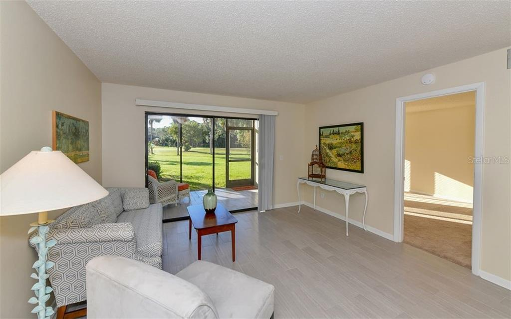 Beautiful view from the Living/Dining room - Condo for sale at 4576 Longwater Chase #59, Sarasota, FL 34235 - MLS Number is A4418168