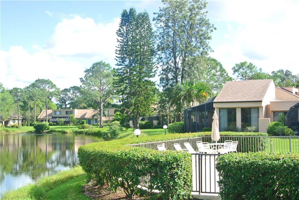 Path to the pool. - Villa for sale at 5235 Myrtle Wood #18, Sarasota, FL 34235 - MLS Number is A4418558