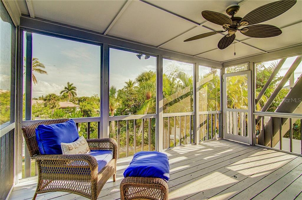 Open the French doors to your wonderful screened porch off the great room! - Single Family Home for sale at 521 75th St, Holmes Beach, FL 34217 - MLS Number is A4420243