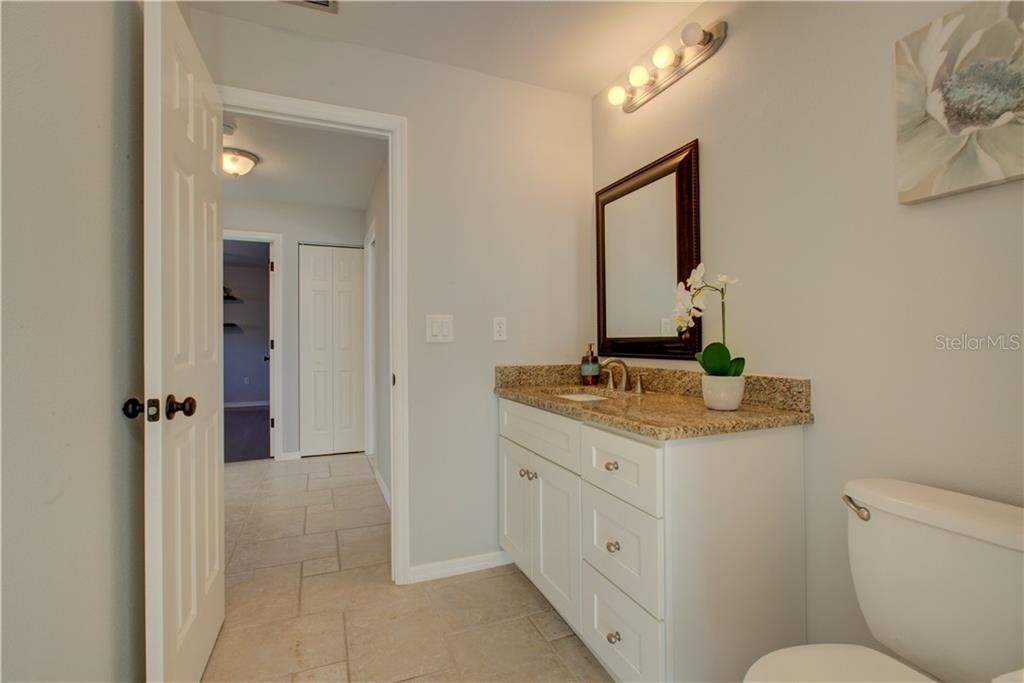 2nd Bathroom with granite countertops - Single Family Home for sale at 5167 Kestral Park Ln, Sarasota, FL 34231 - MLS Number is A4421162