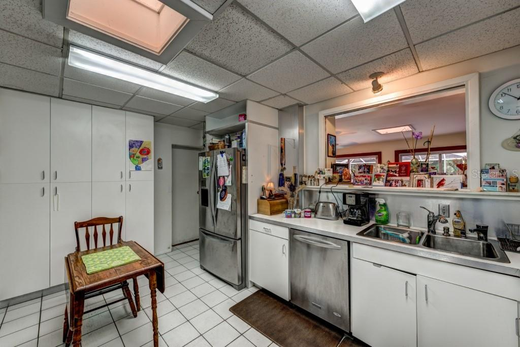 The kitchen opens to the large Florida room and measures 13 x 16, plenty of space to re-design to your liking or update with your own personal touches. - Single Family Home for sale at 1509 Flower Dr, Sarasota, FL 34239 - MLS Number is A4421898