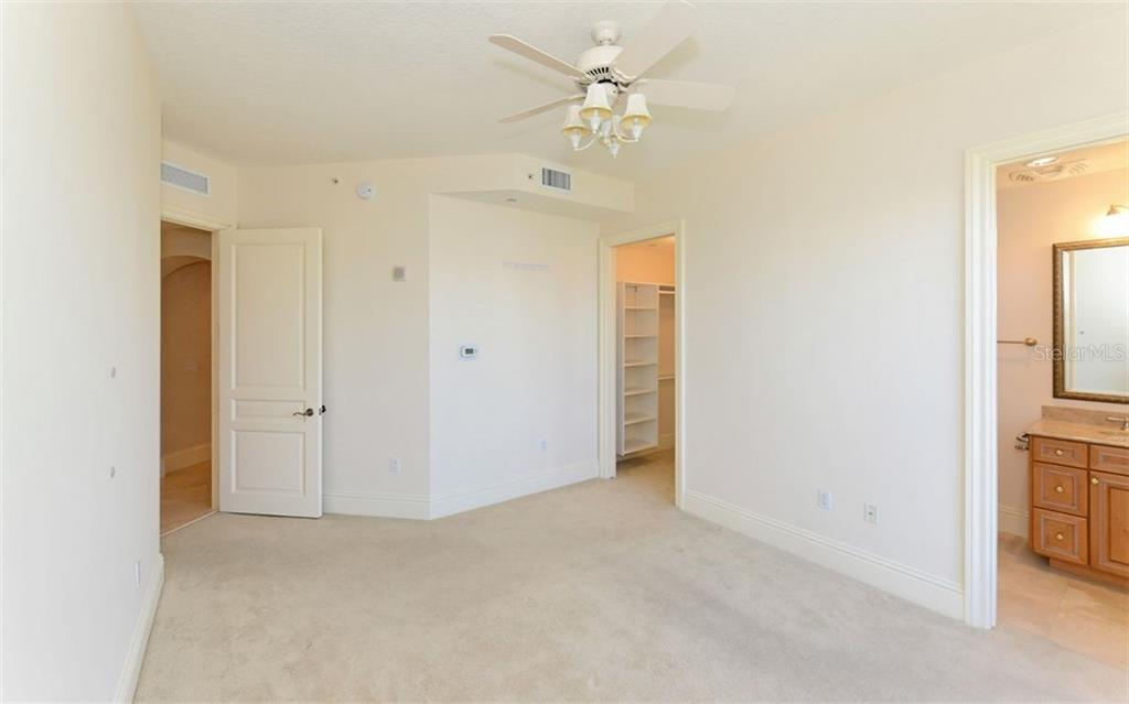 Guest En Suite #1 with bath and fitted closet. - Condo for sale at 464 Golden Gate Pt #701, Sarasota, FL 34236 - MLS Number is A4422622
