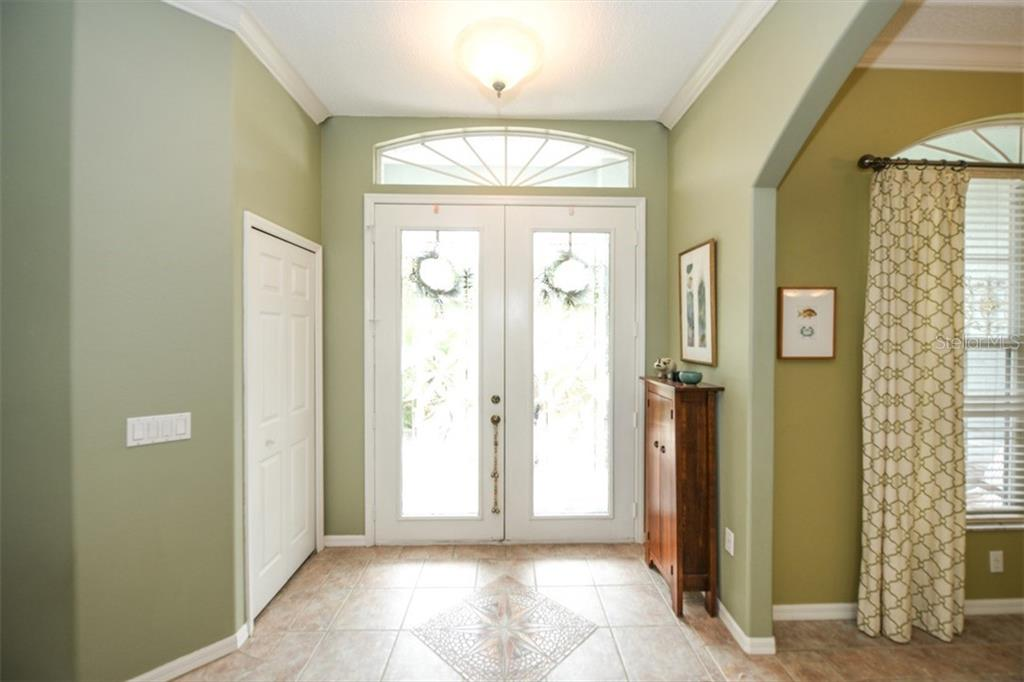 Interior entrance doors - Single Family Home for sale at 6161 Varedo Ct, Sarasota, FL 34243 - MLS Number is A4422883