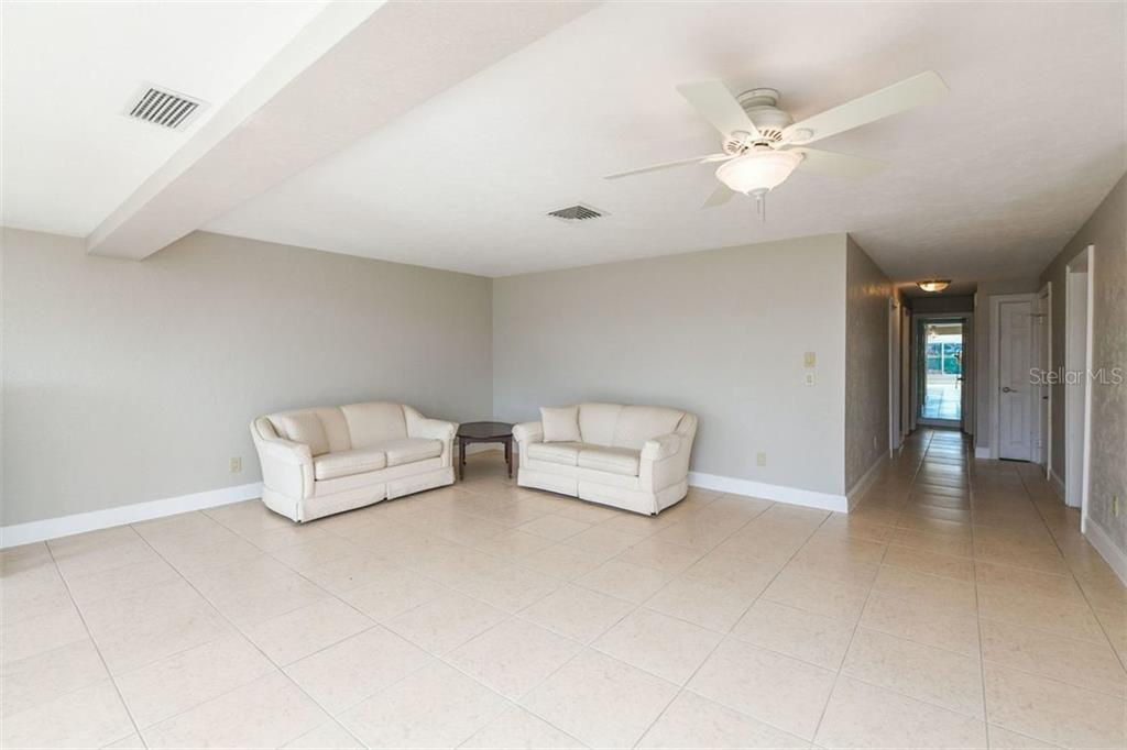 Entry area and living room. - Villa for sale at 3434 Medford Ln #1110, Sarasota, FL 34239 - MLS Number is A4422897
