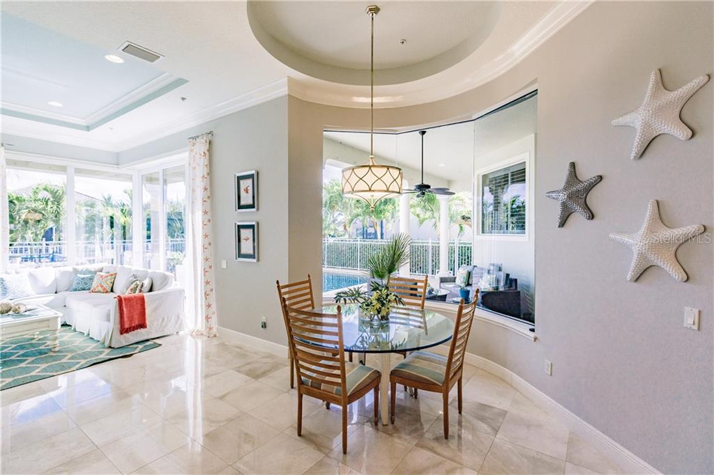 Cafe with aquarium window and view of the pool - Single Family Home for sale at 557 Fore Dr, Bradenton, FL 34208 - MLS Number is A4423161