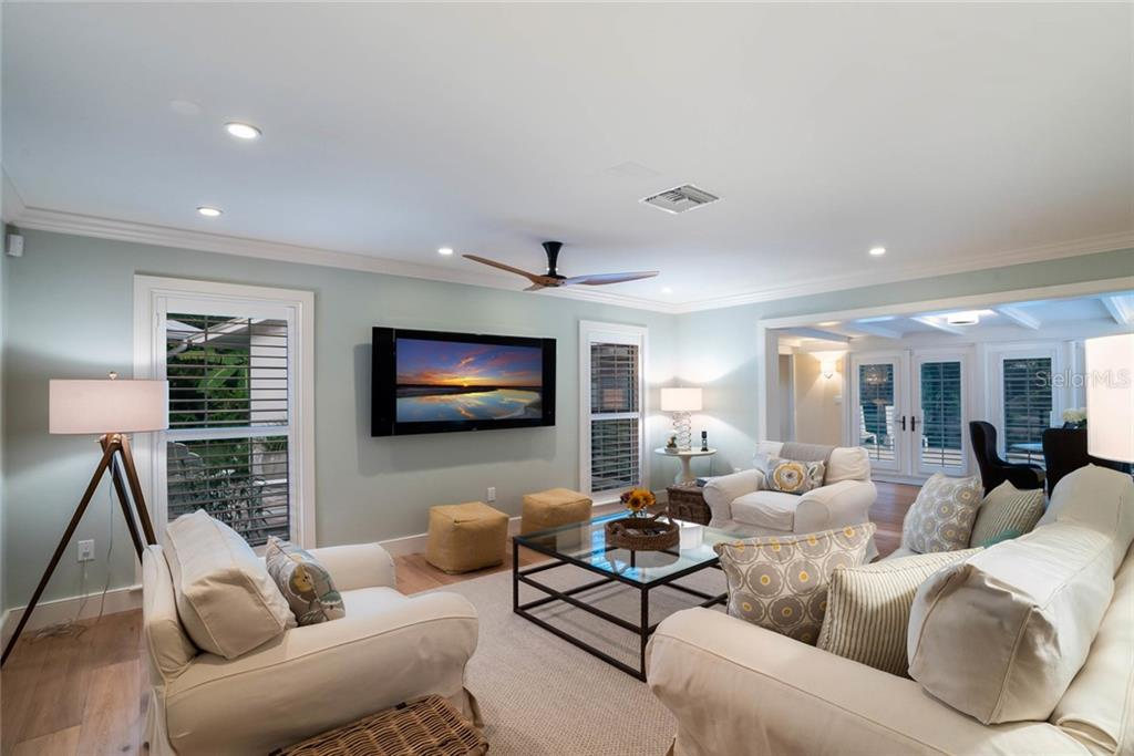Open living space with beautiful oak floors throughout - Single Family Home for sale at 6957 Belgrave Dr, Sarasota, FL 34242 - MLS Number is A4423362