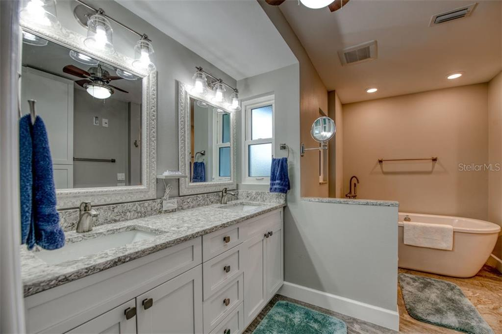 New master bathroom with garden tub. - Single Family Home for sale at 5548 Shadow Lawn Dr, Sarasota, FL 34242 - MLS Number is A4423461