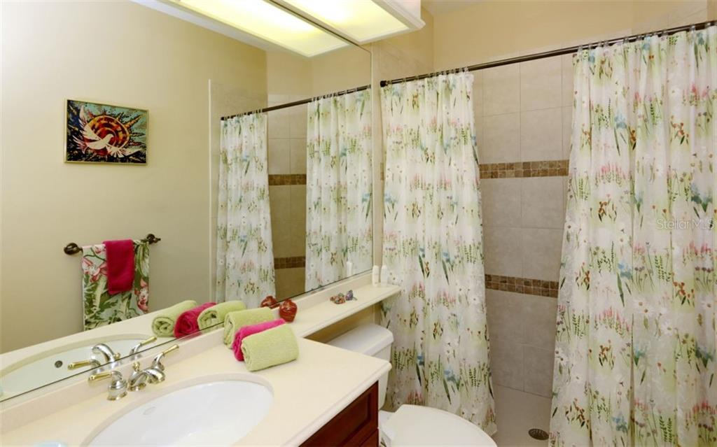 Upstairs bathroom - Single Family Home for sale at 5331 Hunt Club Way, Sarasota, FL 34238 - MLS Number is A4424337