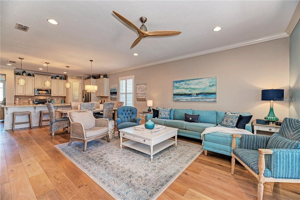 The can lighting, custom fans, and real hardwood floors add a special touch to this Living Space! - Single Family Home for sale at 5260 Bentgrass Way, Bradenton, FL 34211 - MLS Number is A4424484
