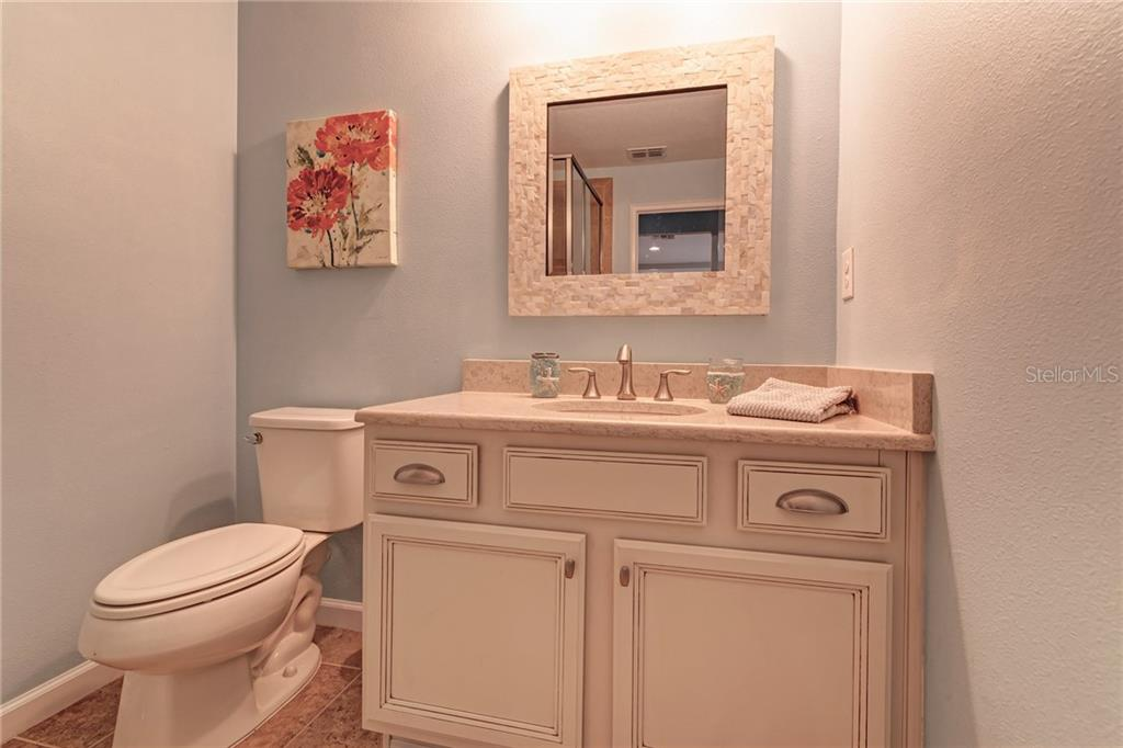 The 3rd bathroom features beautiful quartz counters and a custom mirror! - Single Family Home for sale at 5260 Bentgrass Way, Bradenton, FL 34211 - MLS Number is A4424484